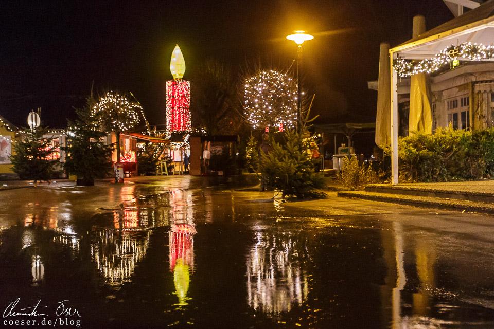 Die riesige Kerze, das Wahrzeichen des Adventmarkts St. Gilgen
