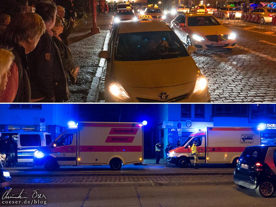 Taxis und Notarztwagen vor dem Münchner Oktoberfest