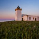 Duncansby Head Lighthouse während des Sonnenuntergangs
