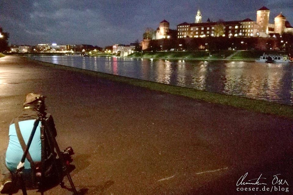 Fotograf Christian Öser während der Arbeit in Krakau