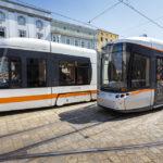 Zwei Straßenbahnen in der Station Hauptplatz in Linz